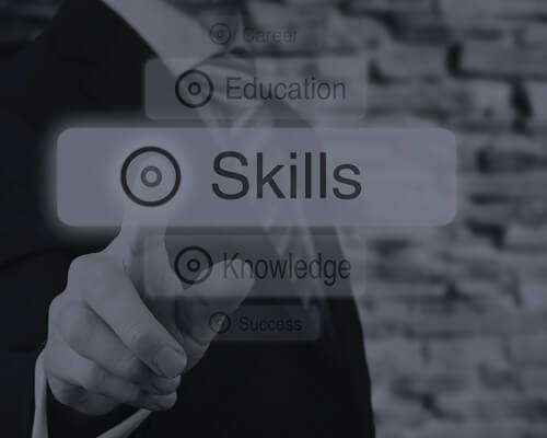 Image of a man pointing to words like skills, knowledge, and education. Link to a page on LSA Global.com about how to develop top talent.