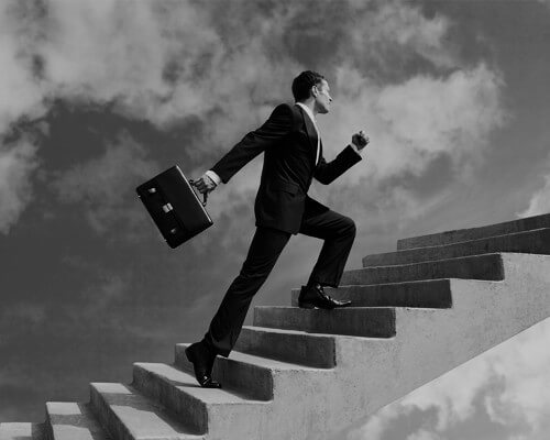 Image of a man walking up a staircase. Link to a page on LSA Global.com about how to transition from an individual contributor to a manager.