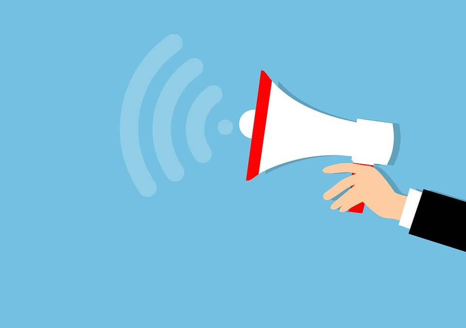 a megaphone with New Manager Tips to Advocate