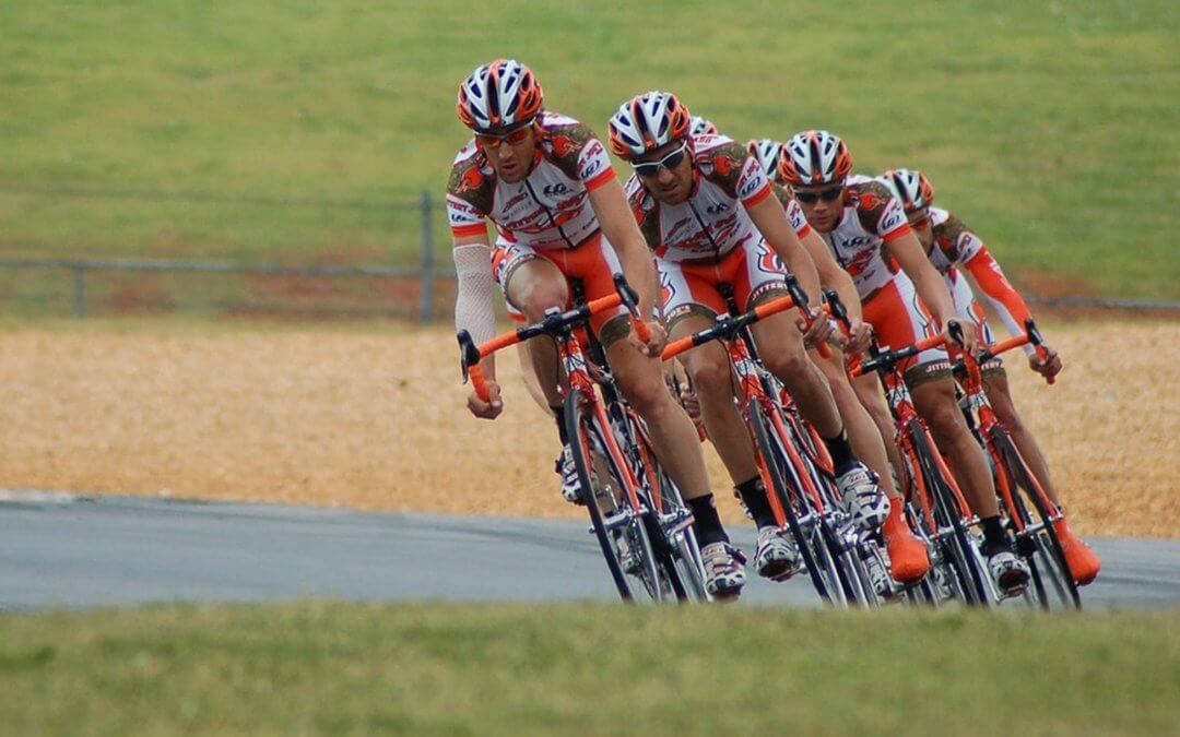 a group of cyclsts illustrate more collaborative teams